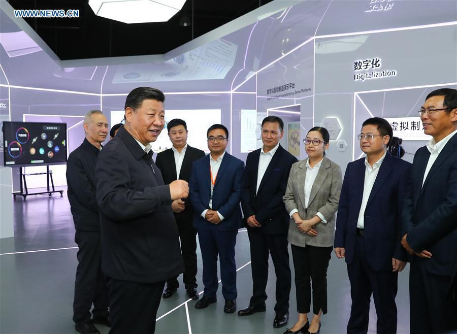 Chinese President Xi Jinping, also general secretary of the Communist Party of China Central Committee and chairman of the Central Military Commission, talks with heads of middle and small-sized private enterprises at an automotive equipment company in Guangzhou, capital of south China\'s Guangdong Province, during an inspection tour, Oct. 24, 2018. (Xinhua/Xie Huanchi)
