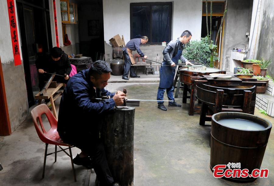 "Fan Zhihua and his apprentices make swords in Songxi County, East China's Fujian Province. Zhanlu Mountain in southern Songxi, well-known for its long history and strong culture, is said to have been the home to the most revered among top five most famous swords in ancient China. Chinese poets in the Tang and Song dynasties, including Du Fu, Li Bai and Su Shi, penned lines in praise of the Zhanlu swords, nicknamed as the ""No. 1 Sword Under the Heaven"". In 1985, local craftsmen went to huge efforts, reading historical literature and working with research institutes in Beijing and Nanjing, to finally craft Zhanlu swords by hand again. Making a Zhanlu sword involves more than 100 time-consuming steps, including forging, quenching and grinding. (Photo: China News Service/Zhang Bin)"