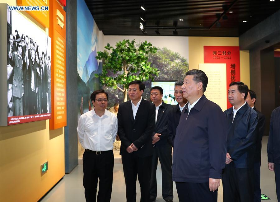 Chinese President Xi Jinping, also general secretary of the Communist Party of China Central Committee and chairman of the Central Military Commission, visits an exhibition on Guangdong\'s development during the past 40 years since the reform and opening up in Shenzhen, south China\'s Guangdong Province, during an inspection tour, Oct. 24, 2018. (Xinhua/Xie Huanchi)