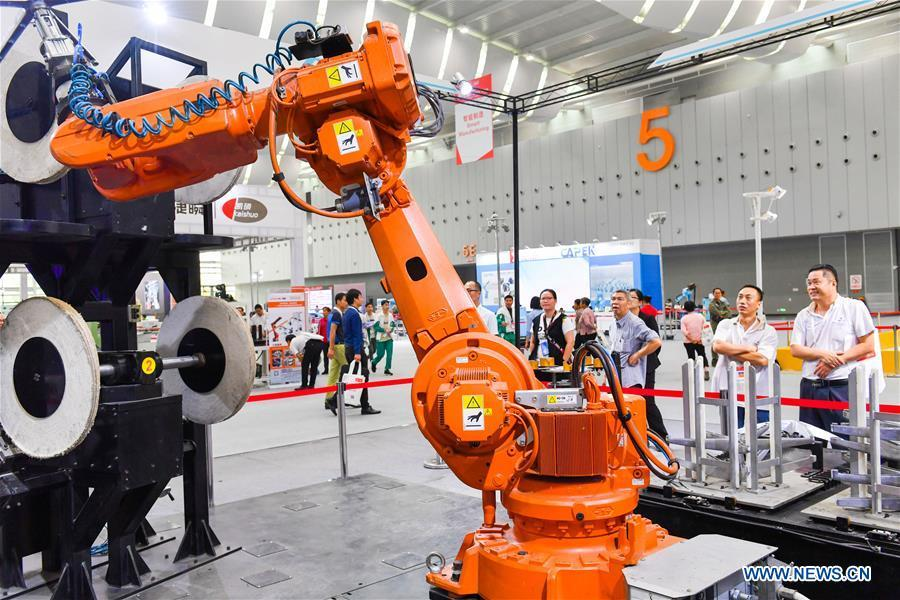 A robot is displayed at the Internet Plus Expo in Shunde District of Foshan, south China\'s Guangdong Province, Oct. 25, 2018. Themed with \
