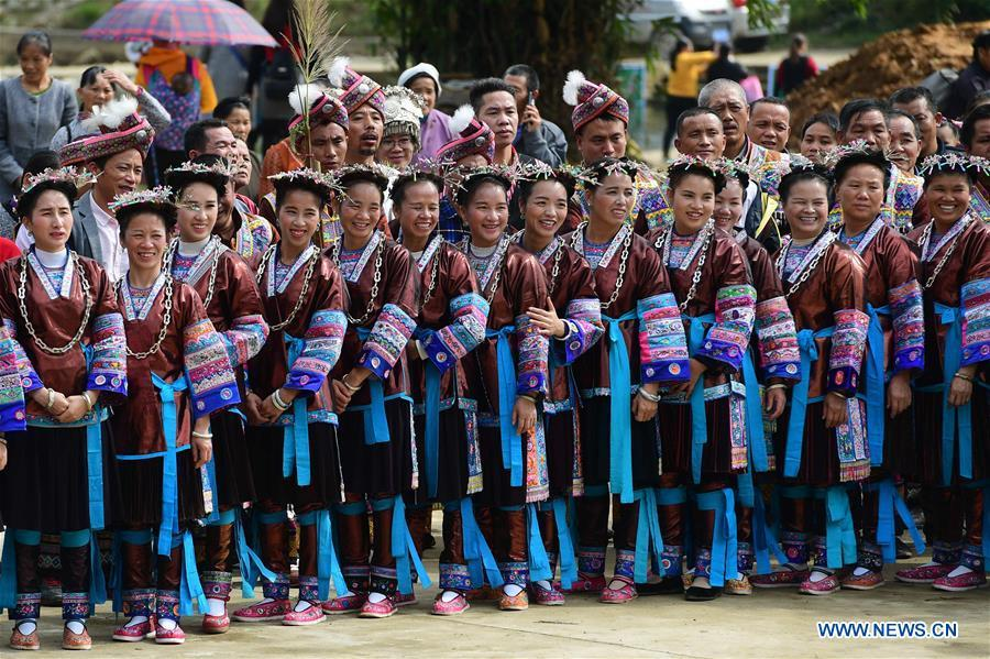 People of Dong ethnic group view performances during a harvest festival in Dongtou Village, Rongshui Miao Autonomous County, south China\'s Guangxi Zhuang Autonomous Region, Oct. 26, 2018. Local people celebrated harvest Friday through various activities like fish feast, singing and playing lusheng. (Xinhua/Huang Xiaobang)