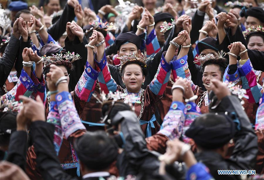 People dance during a harvest festival in Dongtou Village, Rongshui Miao Autonomous County, south China\'s Guangxi Zhuang Autonomous Region, Oct. 26, 2018. Local people celebrated harvest Friday through various activities like fish feast, singing and playing lusheng. (Xinhua/Lan Hongguang)