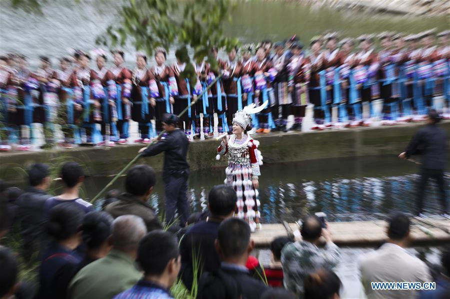 A singer of Miao ethnic group sings during a harvest festival in Dongtou Village, Rongshui Miao Autonomous County, south China\'s Guangxi Zhuang Autonomous Region, Oct. 26, 2018. Local people celebrated harvest Friday through various activities like fish feast, singing and playing lusheng. (Xinhua/Lan Hongguang)
