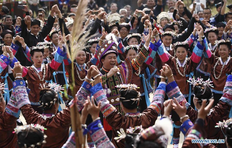 People sing and dance during a harvest festival in Dongtou Village, Rongshui Miao Autonomous County, south China\'s Guangxi Zhuang Autonomous Region, Oct. 26, 2018. Local people celebrated harvest Friday through various activities like fish feast, singing and playing lusheng. (Xinhua/Lan Hongguang)