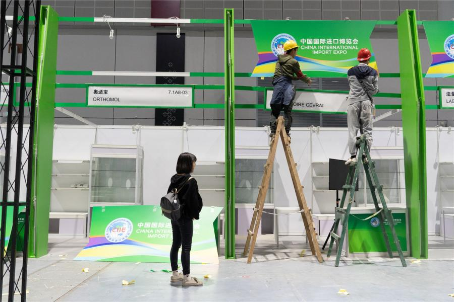Stands of French food supplements and nutritional products provider Laboratoire Cevrai and German food supplements and dietary foods provider Orthomol are seen under construction. (Photo/chinadaily.com.cn)