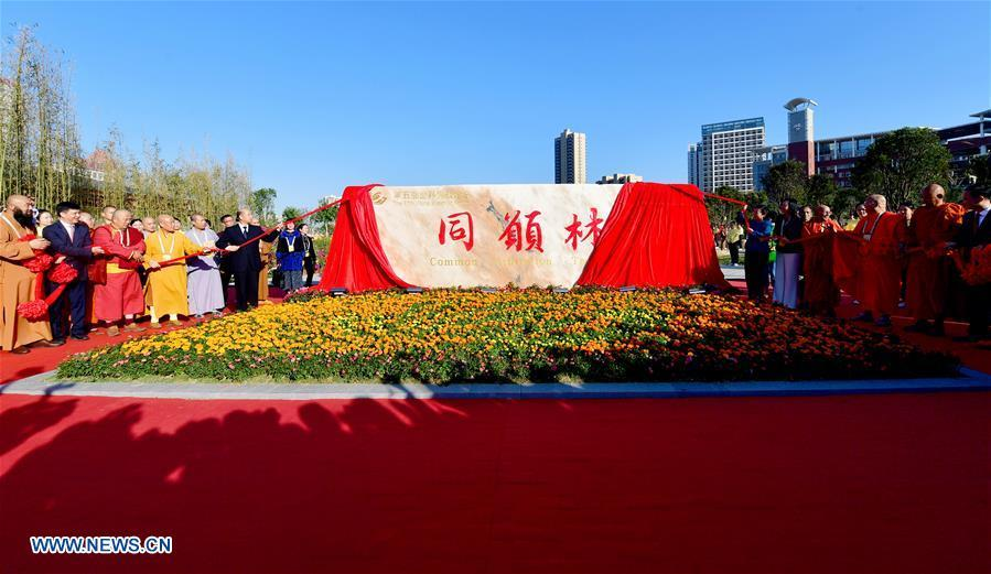Guests for the fifth World Buddhist Forum attend an inauguration ceremony for a memorial at Nanhu Park in Putian, southeast China\'s Fujian Province, Oct. 28, 2018. A record number of over 1,000 Buddhists, scholars and representatives from 55 countries and regions attended the fifth World Buddhist Forum, which will last until Oct. 30.(Xinhua/Wei Peiquan)
