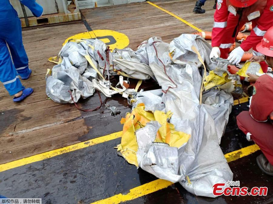 Workers of PT Pertamina examine recovered debris of what is believed from the crashed Lion Air flight JT610, onboard Prabu ship owned by PT Pertamina, off the shore of Karawang regency, West Java province, Indonesia, Oct. 29, 2018. An aircraft with 188 people on board is believed to have sunk after crashing into the sea off Indonesia's island of Java on Monday, shortly after takeoff from the capital on its way to the country's tin-mining hub, officials said. (Photo/Agencies)