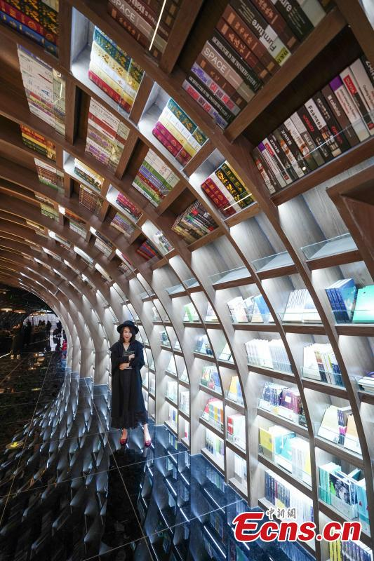 Neatly-arranged books are set on shelves at a new outlet of the Zhongshuge bookstore in Guiyang City, Southwest China's Guizhou Province, Oct. 29, 2018. The design of the store took inspiration from the karst landforms of the province and features other signature tourism and cultural icons, making it a fresh attraction for local readers and other visitors. (Photo: China News Service/He Junyi)