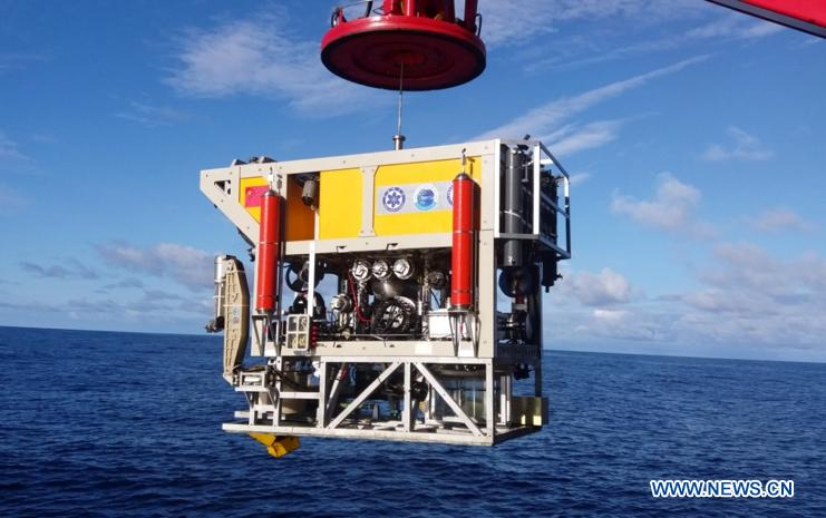 Photo taken on Oct. 16, 2018 shows Haixing 6000, one of China\'s underwater robots, ready for diving during a research expedition. Haixing 6000 set a national depth record for a Chinese remotely operated vehicle, by diving 6,001 meters below sea surface during its first research expedition, scientists told Xinhua Sunday. Haixing 6000 was developed by a team at the Shenyang Institute of Automation under the Chinese Academy of Sciences. It is the first remotely operated underwater vehicle built by China that is capable of diving 6,000 meters, said Li Zhigang, chief scientist of the team. It reached a maximum depth of 6,001 meters, and completed a series of underwater tasks in three hours, including deep-sea observation, biological research, soil and water sample collection, and a simulative black box search. (Xinhua)