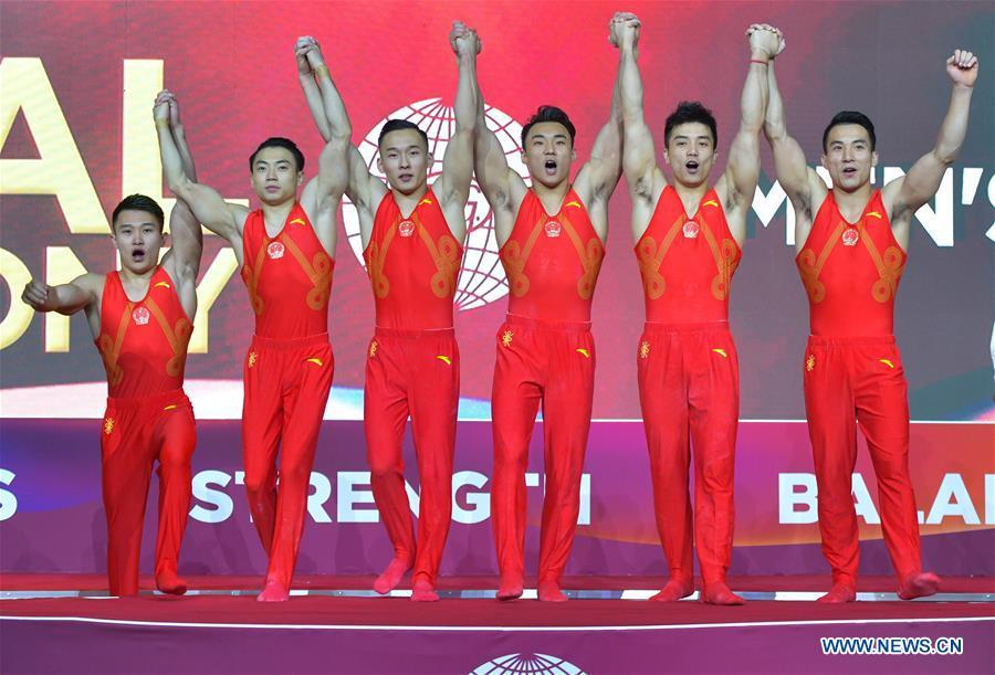 Members of team China celebrate on the podium after winning the Men\'s Team Final at the 2018 FIG Artistic Gymnastics Championships in Doha, capital of Qatar, Oct. 29, 2018. Team China won the gold medal. (Xinhua/Nikku)