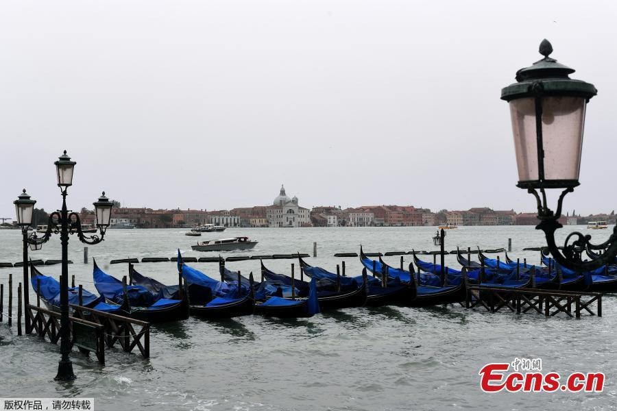 Gondolas are seen in the flooded Riva degli Schiavoni in front of the San Giorgio church during a high-water alert in Venice on October 29, 2018. The flooding, caused by a convergence of high tides and a strong Sirocco wind, reached around 150 centimetres on October 29. (Photo/Agencies)