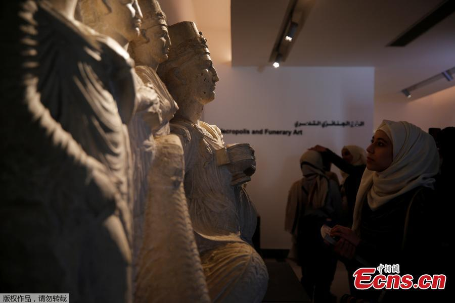 Visitors look at sculptures displayed during the reopening of Syria\'s National Museum of Damascus, Syria October 28, 2018. Syria's National Museum of Damascus opened its rich trove of antiquities to visitors again on October 28, over six years after war forced them to close and months after the government recaptured all rebel areas near the capital. (Photo/Agencies)