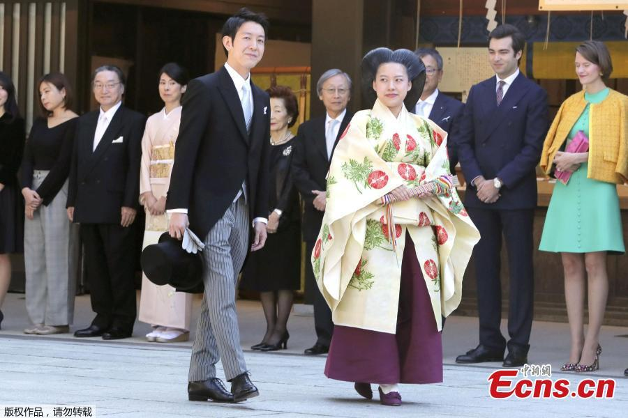 Photo taken on Oct. 29, 2018 shows Japan\'s Princess Ayako married a commoner at Meiji Shrine in Tokyo, Japan. The wedding ceremony included an exchange of rings and a sharing of a cup of sake, according to Japanese media. Ayako, 28, is the daughter of the emperor\'s cousin, and Moriya, 32, works for major shipping company Nippon Yusen. (Photo/Agencies)