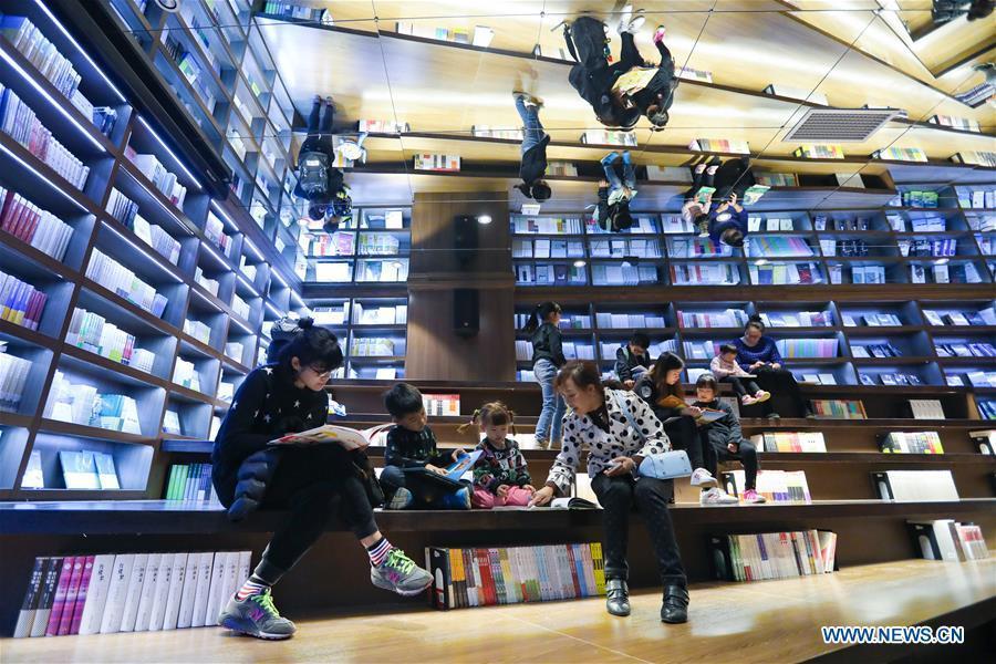 People read at a bookstore named Zhongshuge in Guanshanhu District of Guiyang, southwest China\'s Guizhou Province, Oct. 28, 2018. The design of the bookstore Zhongshuge is inspired by the unique karst landform in Guizhou. (Xinhua/Liu Xu)