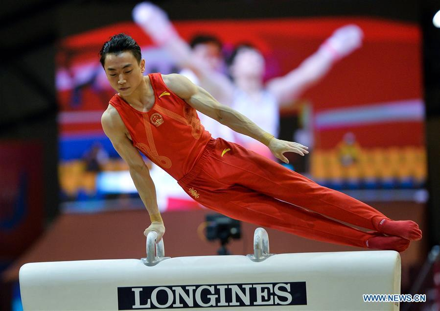 Zou Jingyuan of China competes on the pommel horse during the Men\'s Team Final at the 2018 FIG Artistic Gymnastics Championships in Doha, capital of Qatar, Oct. 29, 2018. Team China won the gold medal. (Xinhua/Nikku)