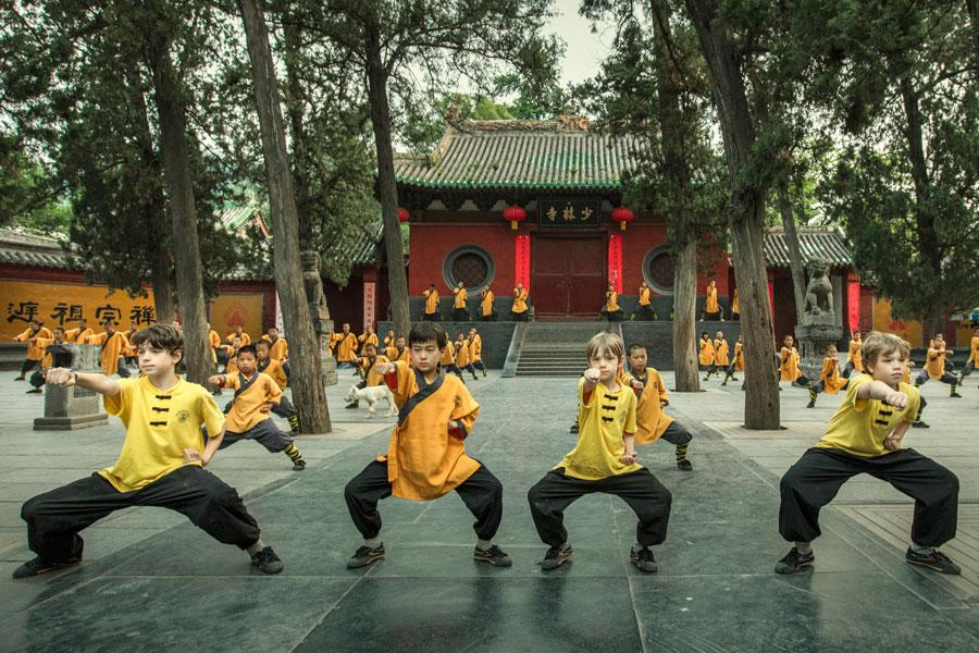 Foreign children practice martial arts at Shaolin Temple in Central China\'s Henan Province in June, 2017. (Photo by Li Tieqiang/For China Daily)