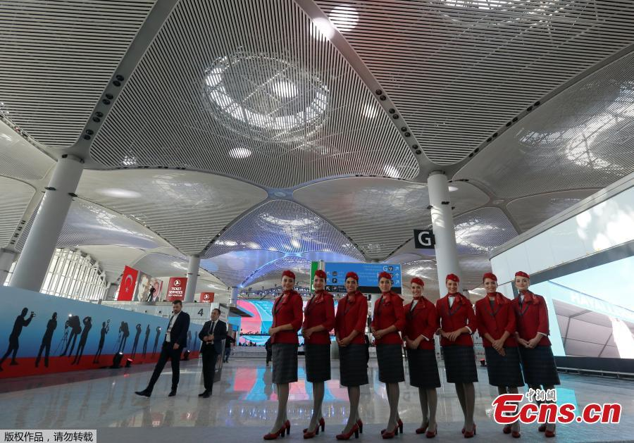 Turkish Airlines stewardesses pose at a terminal of the Istanbul\'s new airport prior to the official opening ceremony, in Istanbul, Turkey, Oct. 29, 2018. (Photo/Agencies)