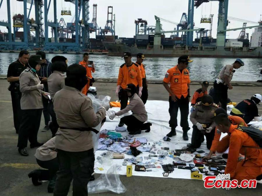 Rescue workers lay out recovered belongings believed to be from the crashed Lion Air flight JT610 at Tanjung Priok port in Jakarta, Indonesia, Oct. 30, 2018. Indonesia on Tuesday stepped up a search for an airliner that plunged into the sea with all 189 aboard feared dead, deploying underwater beacons to trace its black box recorders and uncover why an almost-new plane crashed minutes after take-off. (Photo: China News Service/Lin Yongchuan)