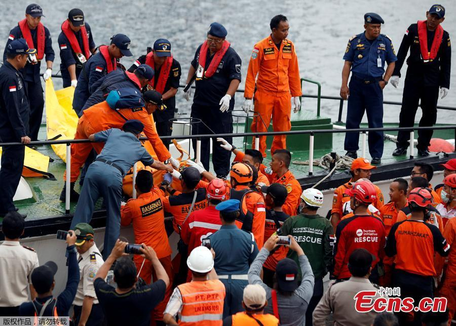 Rescue workers of Lion Air flight JT610 carry a body bag off a boat at Tanjung Priok port in Jakarta, Indonesia, Oct. 30, 2018. The search continued Tuesday for bodies and the \