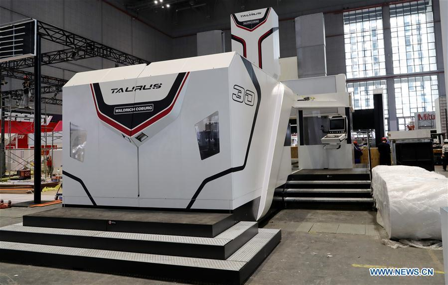 A Taurus milling machine from German Waldrich Coburg is adjusted at an exhibition hall in the National Exhibition and Convention Center (Shanghai) in Shanghai, east China, on Oct. 30, 2018. The final work is underway to get all eight exhibition halls ready for the first China International Import Expo (CIIE), scheduled to be held from Nov. 5 to 10. (Xinhua/Fang Zhe)