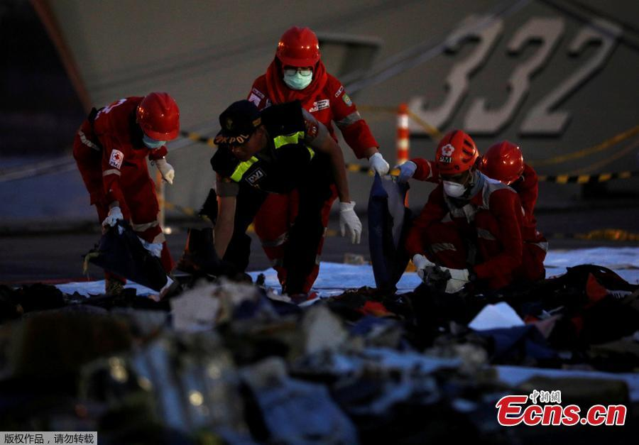 Rescue workers of the crashed Lion Air flight JT610 sort out newly recovered debris at Tanjung Priok port in Jakarta, Indonesia, Oct. 30, 2018. The search continued Tuesday for bodies and the \