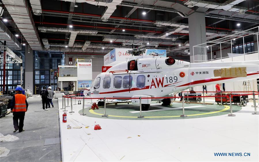 An AW189 helicopter from Italian Leonardo S.p.A. is seen at an exhibition hall in the National Exhibition and Convention Center (Shanghai) in Shanghai, east China, on Oct. 30, 2018. The final work is underway to get all eight exhibition halls ready for the first China International Import Expo (CIIE), scheduled to be held from Nov. 5 to 10. (Xinhua/Fang Zhe)
