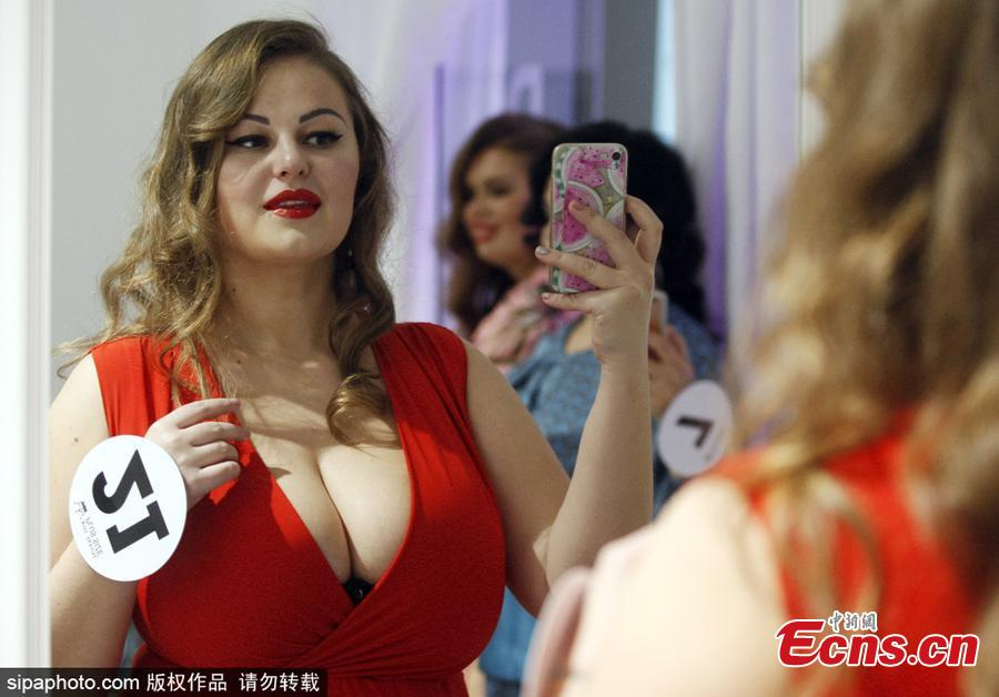 A contestant snaps a selfie backstage before taking to the catwalk in a bid to be crowned the winner of Miss Ukraine Plus Size at the competition in Kiev, Oct. 29, 2018. The winner will represent the country at the Miss World Plus Size pageant in the Philippines next month. (Photo/Sipaphoto)