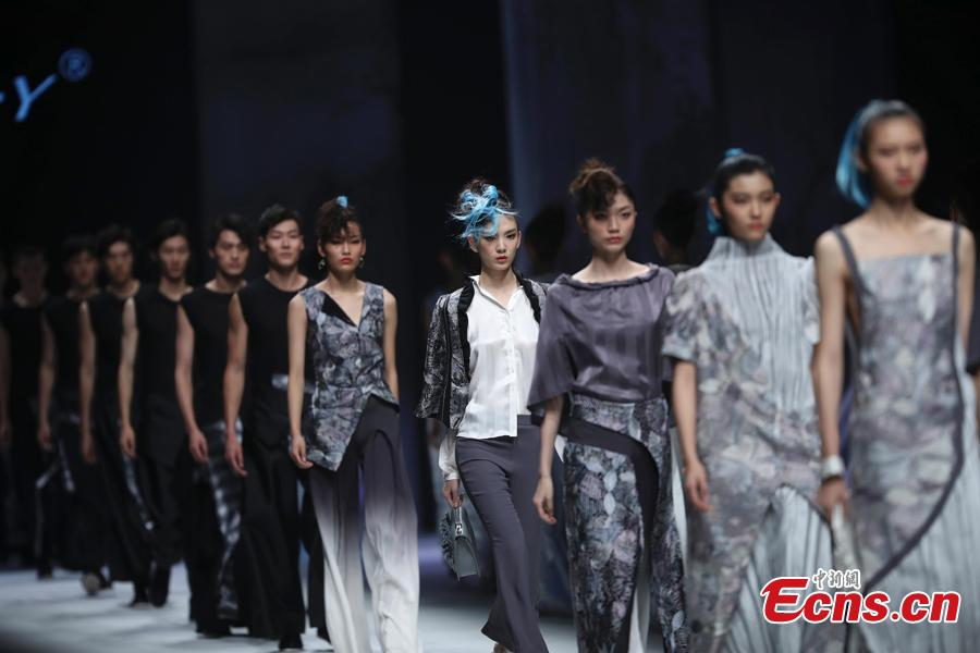 <?php echo strip_tags(addslashes(Models present creations designer Deng Zhaoping at China Fashion Week in Beijing, China, Oct. 30, 2018. (Photo: China News Service/Sheng Jiapeng))) ?>