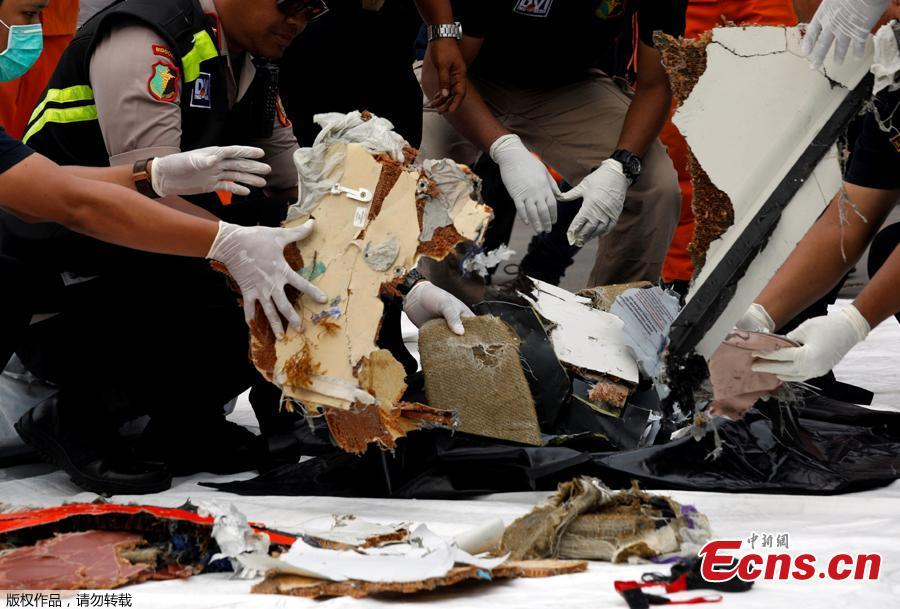 Rescue workers lay out newly recovered debris of Lion Air flight JT610 at Tanjung Priok port in Jakarta, Indonesia, Oct. 30, 2018.  The search continued Tuesday for bodies and the \