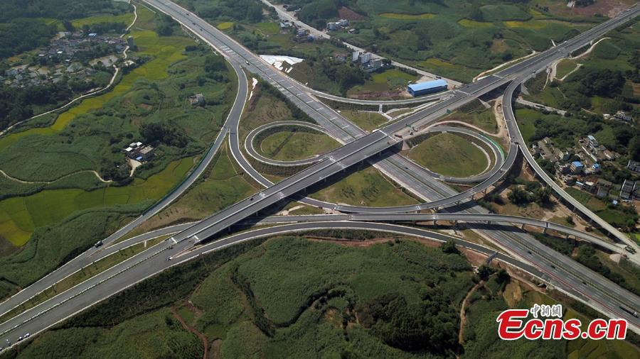 Photo taken from the air shows an expressway linking Nanning Wuxu International Airport with Datang Town of Nanning City, Southwest China's Guangxi Zhuang Autonomous Region, Oct. 30, 2018. The expressway will improve transportation networks among the region's three seaports and Friendship Pass near the border between China and Vietnam when it opens next month. (Photo: China News Service/He Qiudi)