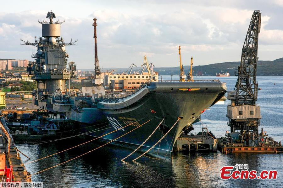 Russia\'s aircraft carrier, the Admiral Kuznetsov, was damaged in Murmansk when the dry dock PD-5 where it was undergoing a refit sank on Oct. 30, 2018, sending a giant crane crashing on to the ship. PD-5 is known as one of the world\'s largest floating dry docks. (Photo/Agencies)