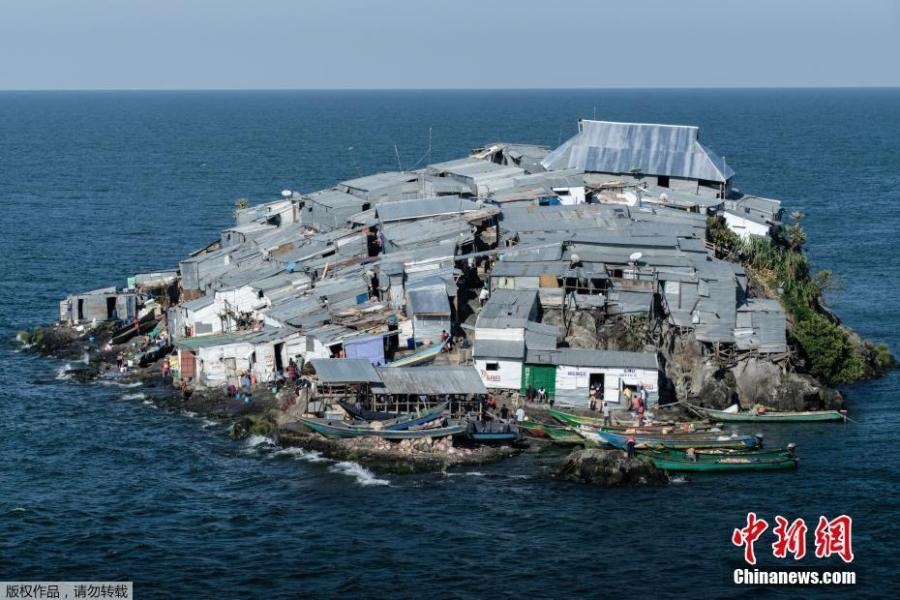 A picture taken on October 5, 2018, shows a general view of Migingo island which is densely populated by residents fishing mainly for Nile perch in Lake Victoria on the border of Uganda and Kenya. A rounded rocky outcrop covered in metallic shacks, Migingo Island rises out of the waters of Lake Victoria like an iron-plated turtle. The densely-populated island is barely a quarter of a hectare large, its residents crammed into a hodge-podge of corrugated-iron homes, with seemingly little but a few bars, brothels and a tiny port to boast of. (Photo/Agencies)