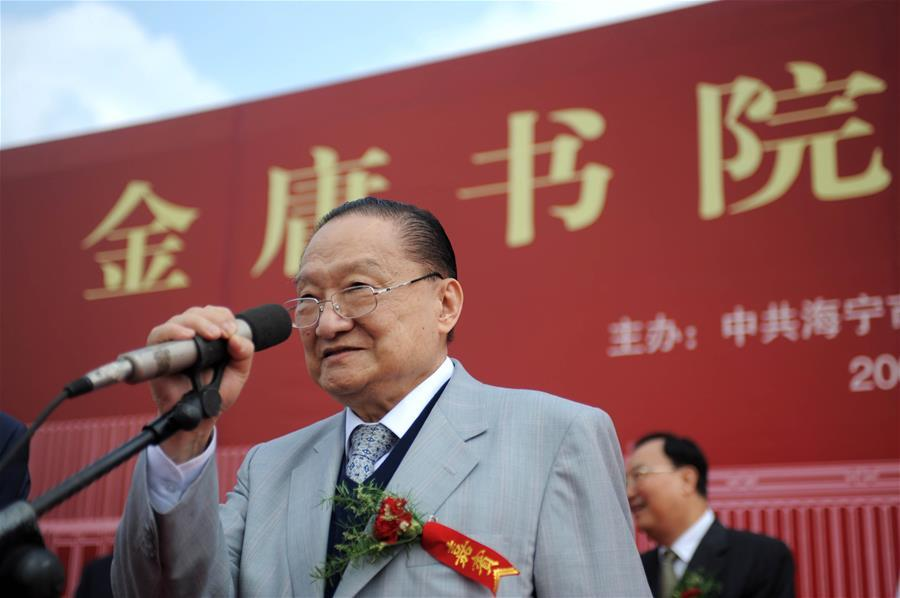 In this file photo, Jin Yong addresses the groundbreaking ceremony of an academy named after him in Haining, east China\'s Zhejiang Province, on Sept. 17, 2008. Famous Chinese martial arts novelist Louis Cha Leung-yung, more widely known by his pen name Jin Yong, died at 94 at a hospital in Hong Kong on Tuesday. Cha created many widespread martial arts novels between 1955 and 1972. Cha, who also co-founded the Hong Kong daily newspaper Ming Pao, has been regarded as one of the greatest and most popular martial arts writers. (Xinhua/Xu Yu)