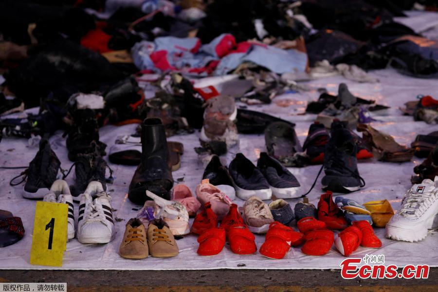 Recovered shoes believed to be from the crashed Lion Air flight JT610 are laid out at Tanjung Priok port in Jakarta, Indonesia, November 1, 2018. (Photo/Agencies)