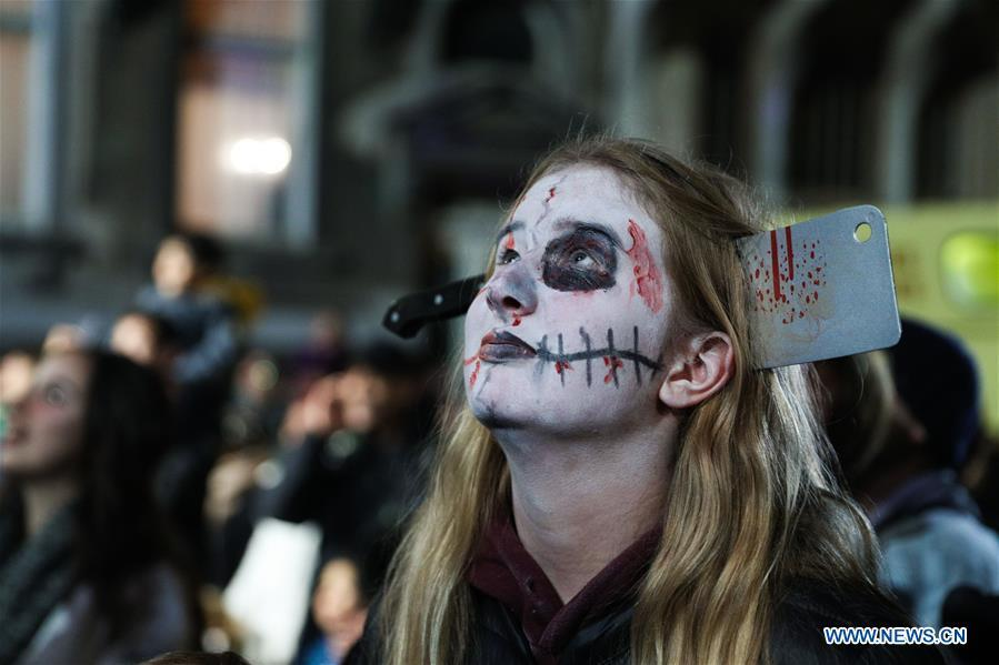 A girl takes part in a Halloween parade in Brussels, Belgium, Oct. 31, 2018. (Xinhua/Zheng Huansong)