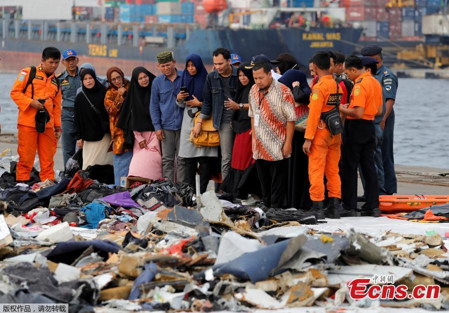 Families of passengers of  Lion Air flight JT610 stand as they look at the belongings of the passengers at Tanjung Priok port in Jakarta, Indonesia, October 31, 2018. (Photo/Agencies)