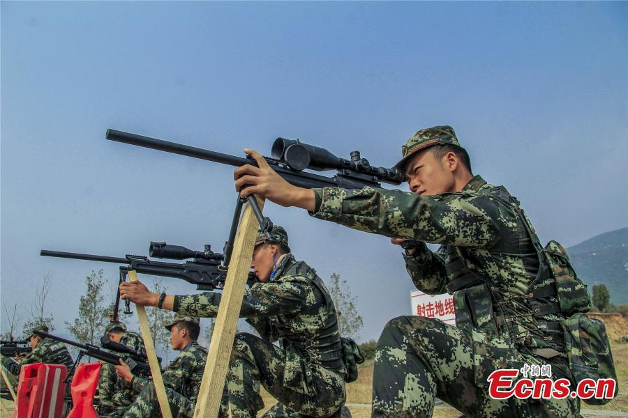 Snipers from a special unit of the Chinese People\'s Armed Police Force sharp their skills during a training at Songshan Mountain, Central China's Henan province.  (Photo: China News Service/ Zhao Hongtao)