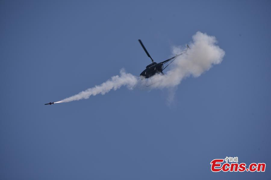 China successfully launched a missile from an unmanned attack helicopter AV500W, with the projectile hitting a target 4.5 kilometers from the aircraft. The aircraft, developed and produced by the Aviation Industry Corp of China, the State-owned aircraft giant, has a maximum takeoff weight of 500 kilograms, a maximum speed of 170 kilometers per hour and a flight ceiling of 5,000 meters.(Photo: China News Service/He Huan)