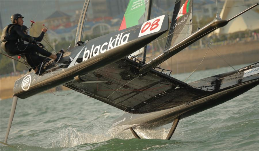 Sailors steer a two-man catamaran as the boat flies above the sea during the 2018 Extreme Sailing Series Qingdao Mazarin Cup. (Photo by Song Guangchang/for chinadaily.com.cn)
