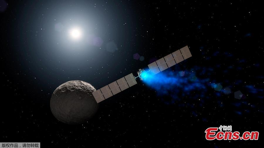 This NASA artist\'s concept obtained November 1, 2018 shows NASA\'s Dawn spacecraft arriving at the dwarf planet Ceres (lower right), travelling through space using a technology called ion propulsion, in which ions are accelerated out of an engine, giving the spacecraft thrust, the xenon ions glow with blue light. Dawn, a NASA spacecraft that launched 11 years ago and studied two of the largest objects in the asteroid belt, has ended its mission after running out of fuel, officials said November 1, 2018. Scientists have known for about a month that Dawn was essentially out of its fuel, hydrazine, which kept the spacecraft\'s antennae oriented toward Earth and helped it turn its solar panels to the Sun to recharge.  Then, the spacecraft missed scheduled communications with NASA\'s Deep Space Network on Wednesday and Thursday, and the space agency declared it formally dead. (Photo/Agencies)