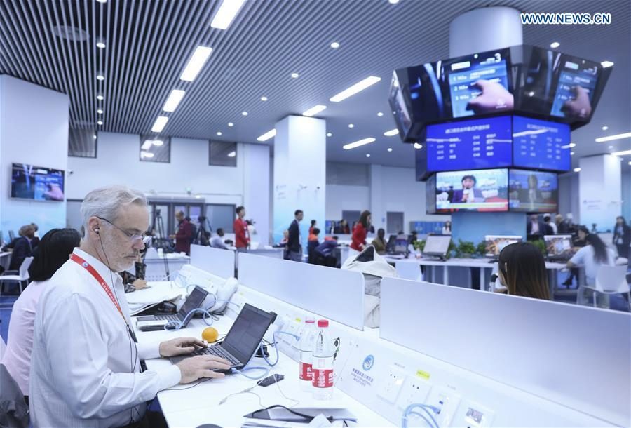 Journalists work at the media center of the first China International Import Expo (CIIE) in Shanghai, east China, Nov. 5, 2018. The first CIIE opened here on Monday and has drawn much attention from domestic and international media. (Xinhua/Lan Hongguang)