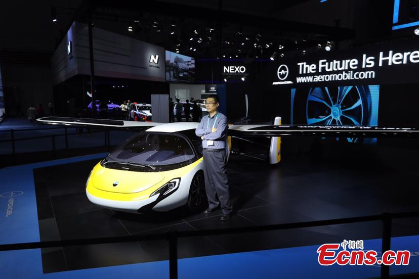A flying car developed by AeroMobil, a Slovakian advanced engineering company is shown at the China International Import Expo (CIIE) opened in Shanghai on November 5, 2018. Integrating innovation in automotive and aerospace fields, the car with wings applies automotive safety standards together with lightweight materials and advanced aerodynamics. This will provide owners with true freedom of movement in the air and on the ground, providing electric propulsion on the road coupled with a lightweight internal combustion engine to provide propulsion in the air. (Photo: China News Service/ Zhang Hengwei)