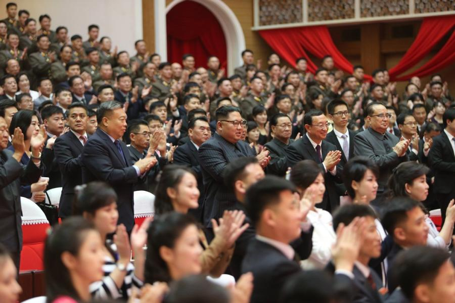 Kim Jong-un (C), top leader of the Democratic People\'s Republic of Korea (DPRK), watches a joint performance presented by literary and art workers from China and DPRK, in Pyongyang, DPRK, on Nov. 3, 2018. (Photo/Xinhua)