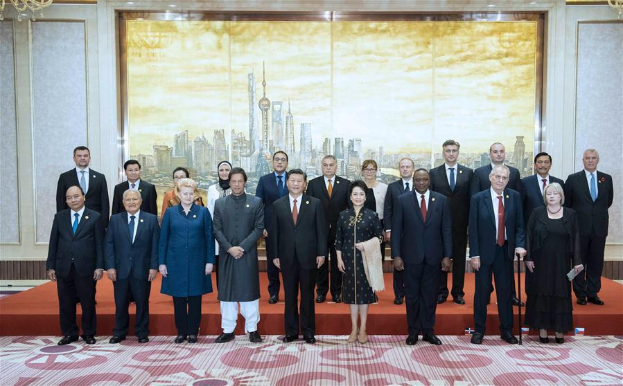 Chinese President Xi Jinping and his wife Peng Liyuan take group photos with foreign leaders and their spouses ahead of a banquet in Shanghai, east China, Nov. 4, 2018. Xi Jinping and his wife Peng Liyuan hosted a banquet on Sunday evening in Shanghai to welcome distinguished guests from around the world, who will attend the first China International Import Expo (CIIE) opening Monday. (Xinhua/Li Tao)