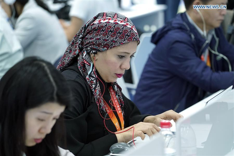 Journalists work at the media center of the first China International Import Expo (CIIE) in Shanghai, east China, Nov. 5, 2018. The first CIIE opened here on Monday and has drawn much attention from domestic and international media.(Xinhua/Shen Bohan)