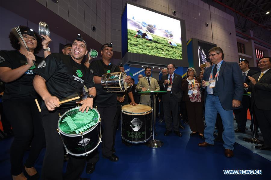 A band from Brazil perform at the Brazil pavilion during the first China International Import Expo (CIIE) in Shanghai, east China, Nov. 5, 2018. A total of 82 countries and three international organizations showcased their achievements in economic and trade development as well as competitive products at 71 booths in the Country Pavilion for Trade and Investment at the CIIE. (Xinhua/Han Yuqing)