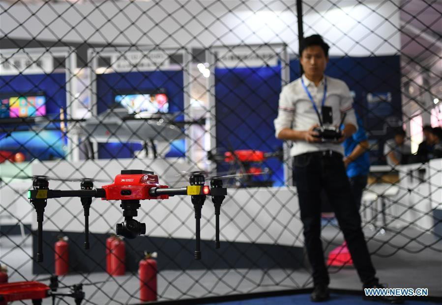 A staff member tests a drone at the UAV (unmanned aerial vehicle) exhibition area of the upcoming China International Aviation and Aerospace Exhibition in Zhuhai, south China\'s Guangdong Province, Nov. 5, 2018. The exhibition is scheduled to be held on Nov. 6-11. (Xinhua/Deng Hua)