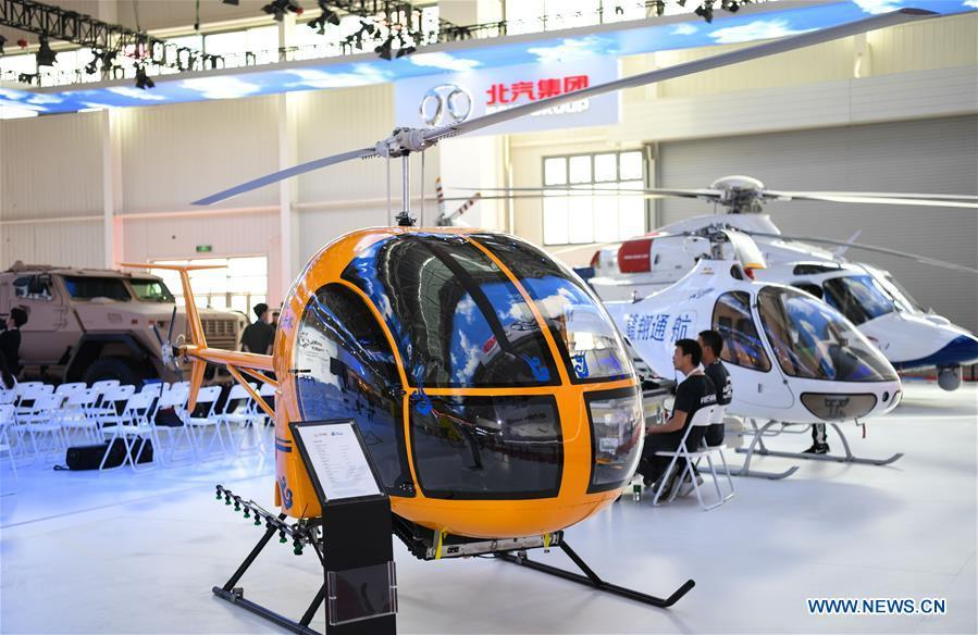 Photo taken on Nov. 5, 2018 shows a civil helicopter at the exhibition area of the upcoming China International Aviation and Aerospace Exhibition in Zhuhai, south China\'s Guangdong Province, Nov. 5, 2018. The exhibition is scheduled to be held on Nov. 6-11. (Xinhua/Deng Hua)