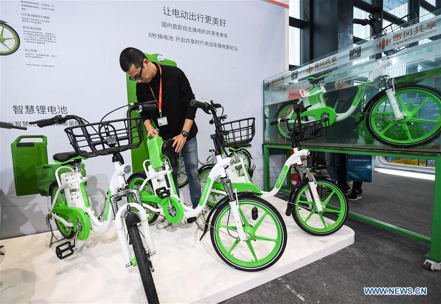 An exhibitor shows an electric bike sharing system at the Light of Internet Expo of the fifth World Internet Conference in Wuzhen Township of Tongxiang, east China\'s Zhejiang Province, Nov. 6, 2018. Opening here on Tuesday, the exposition focuses on the world\'s most recent internet development trends and cutting-edge technologies, showing the latest internet technologies, achievements, products and applications of more than 430 enterprises and institutions from home and abroad. (Xinhua/Xu Yu)