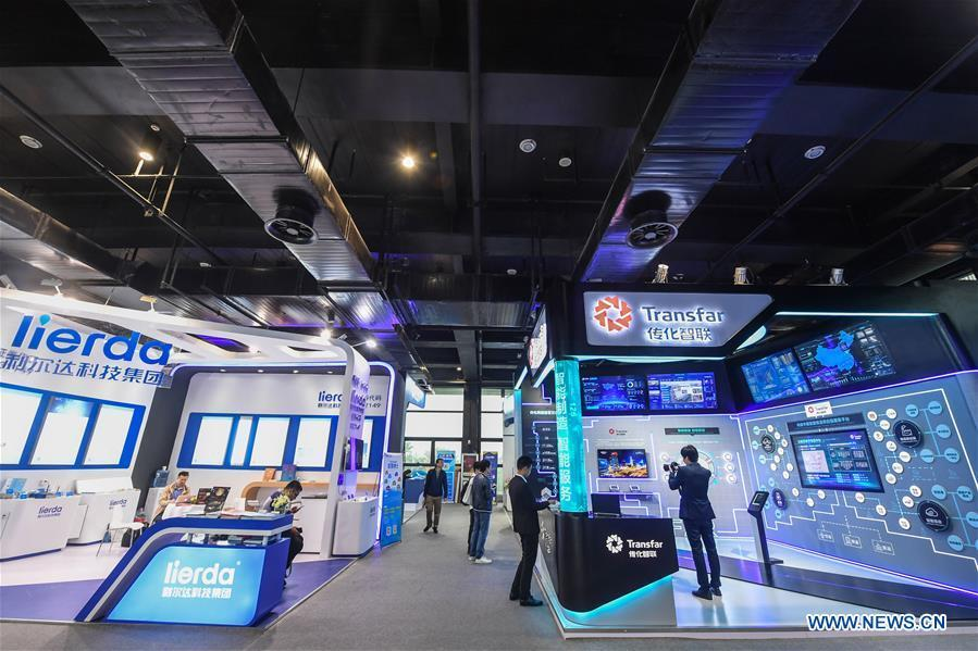 Photo taken on Nov. 6, 2018 shows exhibition booths at the Light of Internet Expo of the fifth World Internet Conference in Wuzhen Township of Tongxiang, east China\'s Zhejiang Province. Opening here on Tuesday, the exposition focuses on the world\'s most recent internet development trends and cutting-edge technologies, showing the latest internet technologies, achievements, products and applications of more than 430 enterprises and institutions from home and abroad. (Xinhua/Xu Yu)